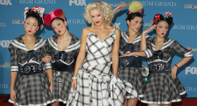 LAS VEGAS - DECEMBER 8: Singer Gwen Stefani and dancers the Harajuku Girls arrive at the 2004 Billboard Music Awards on December 8, 2004 at the MGM Grand Garden Arena, in Las Vegas, Nevada. (Photo by Frazer Harrison/Getty Images)